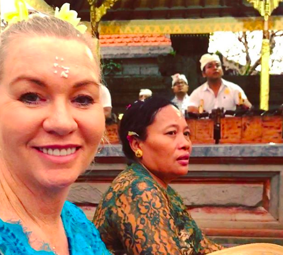 Jules Thomson, of Indah Escapes, wearing a kebaya attending a Balinese ceremony in a Hindu temple.