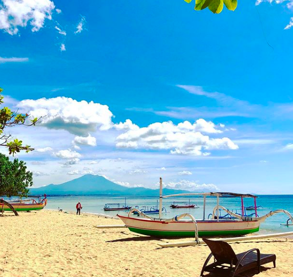 A jukung docked at the beach in Sanur, Bali.