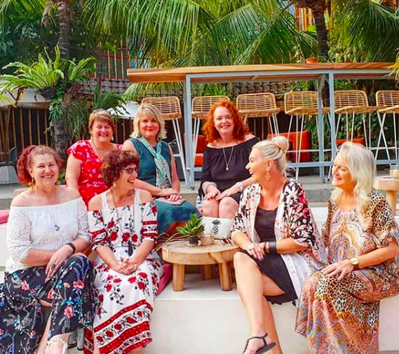 A group of women relaxing and smiling as part of Australian Expat Jules Thomson's Indah Escapes Bali Tour Group