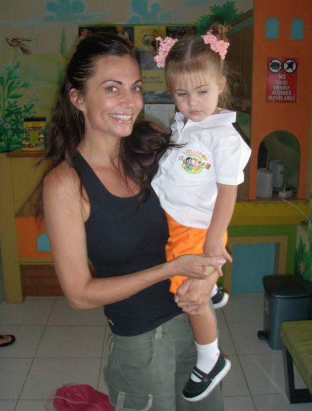 Lee Anna, with her young daughter, Shanti, who is wearing her Lollypop prep-school uniform.