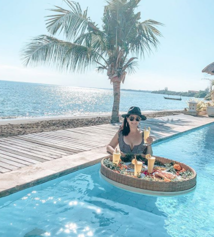 Karlie relaxing in a beach-side pool in Bali.