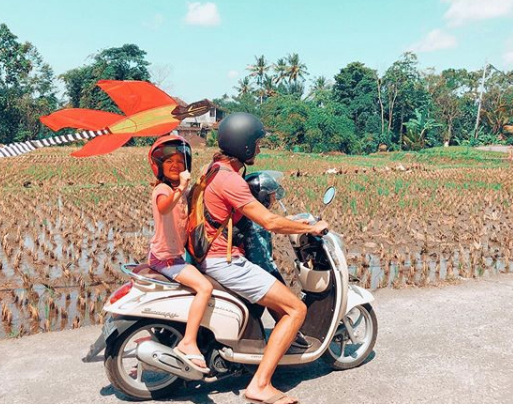 Kite flying and riding motorbike in Bali
