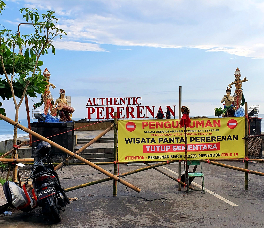 A banner notifying passers by that Pererenan Beach is closed to prevent the spread of COVID-19.