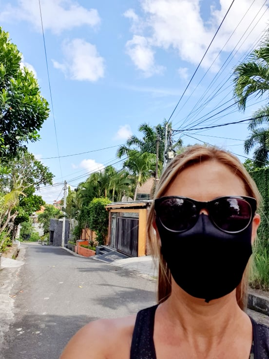 A selfie of Rachel Zubak in a Balinese street, wearing her facemask during the COVID-19 Pandemic.