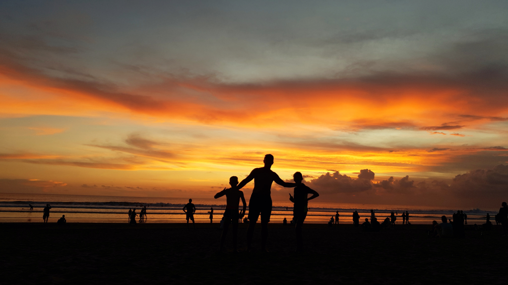 The Zubak family at the beach watching a Bali sunset.