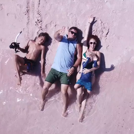 Owners of Alive Wholefoods on a beach