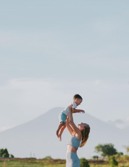 Cath and son Seth in Bali with volcano in background