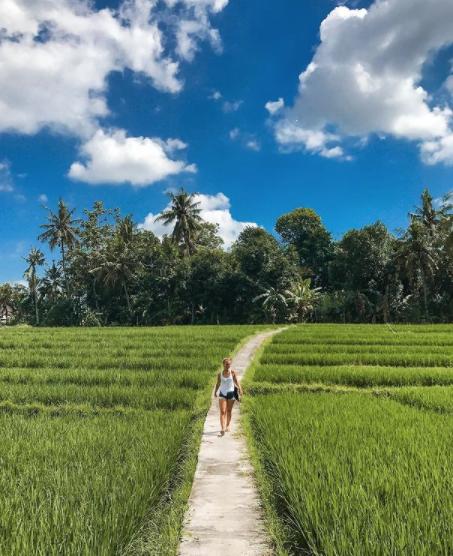 Cath walking through rice fields in Canggu