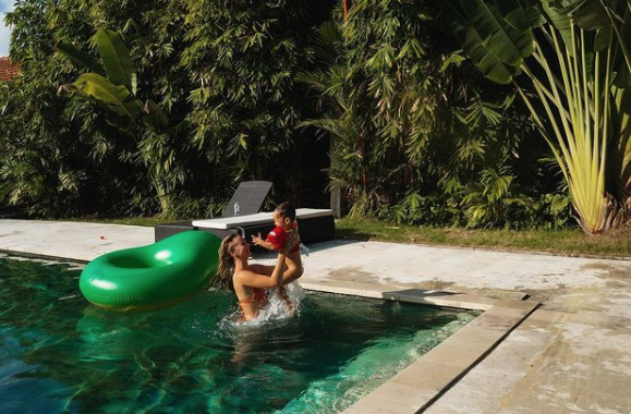 Cath and Seth in swimming pool in villa in Berawa