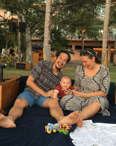 Family with baby poolside in Bali
